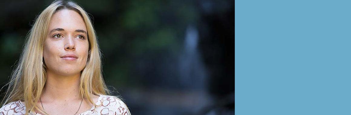 Bhagavad Gita student Aja smiling in nature
