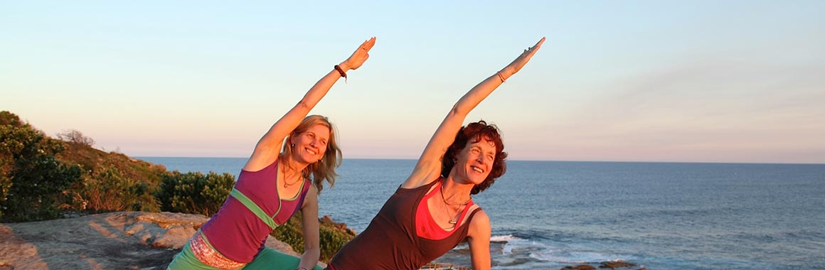 Dru yoga bhima posture by the beach