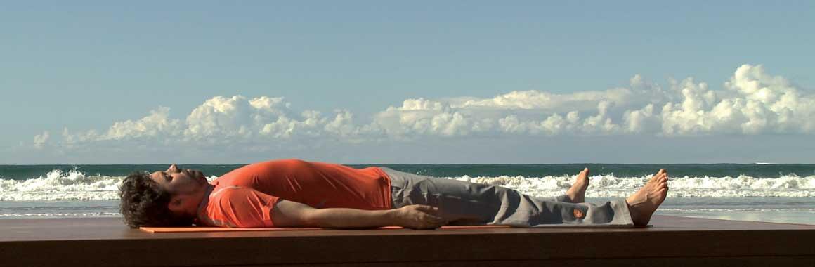 Andrew Wells Dru Yoga teacher trainer, Dru Yoga relaxation, beach