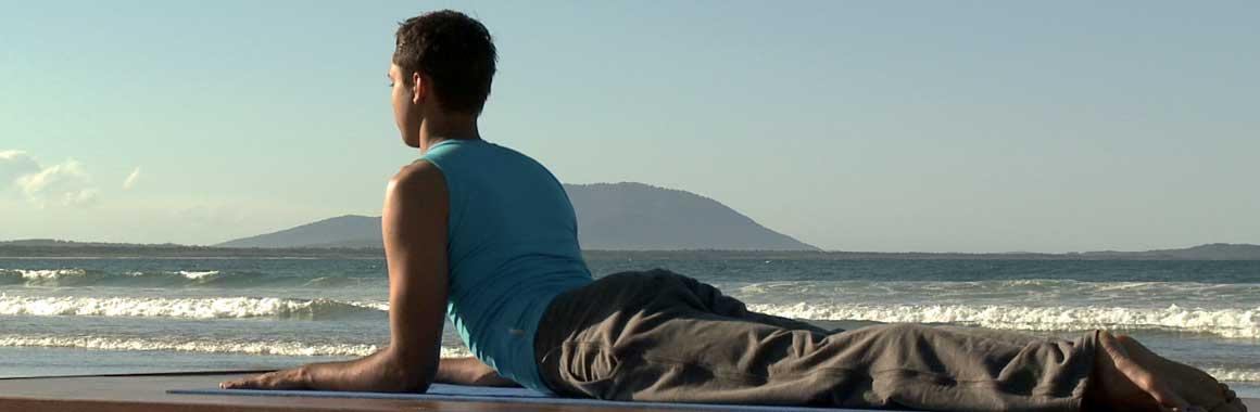 Dru Yoga sphinx posture, beach