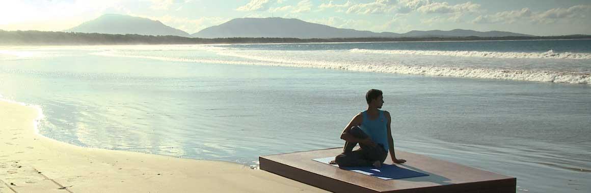 Dru yoga - sitting twist on the beach