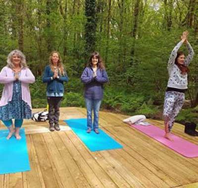 Dru Yoga in the woods in Cornwall
