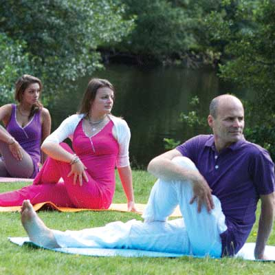 Christiane and Dru Yogis - sitting twist by river