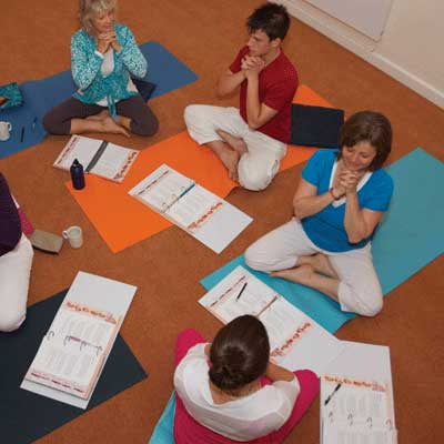 Dru Yoga students learn the Pigeon breath