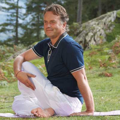 Man does sitting spinal twist