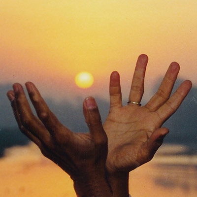 The lotus hand mudra capturing the dawn sunlight