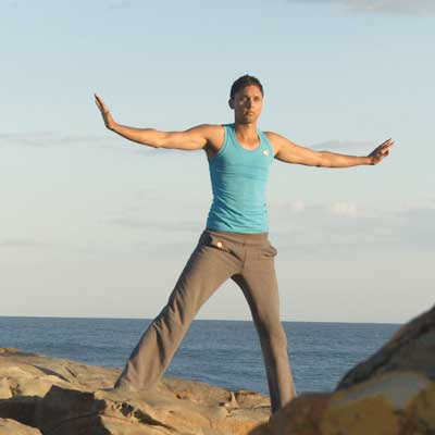 Dru Yoga student enjoying yoga on the beach