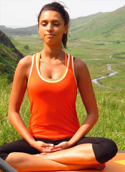 Yoga lotus pose Radha Snowdonia valley