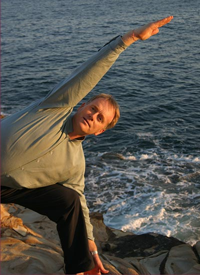 Dru yoga - bhima posture by the beach