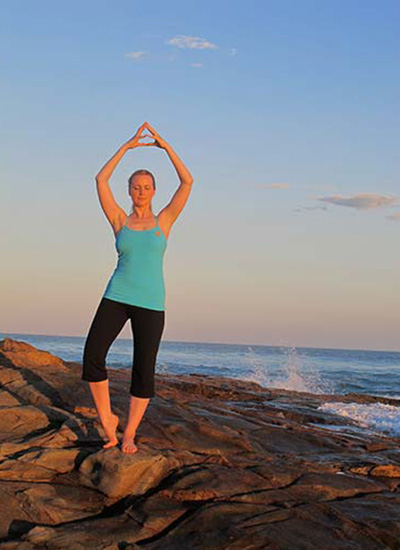 Dru Yoga - practicing energisation mudra on the beach