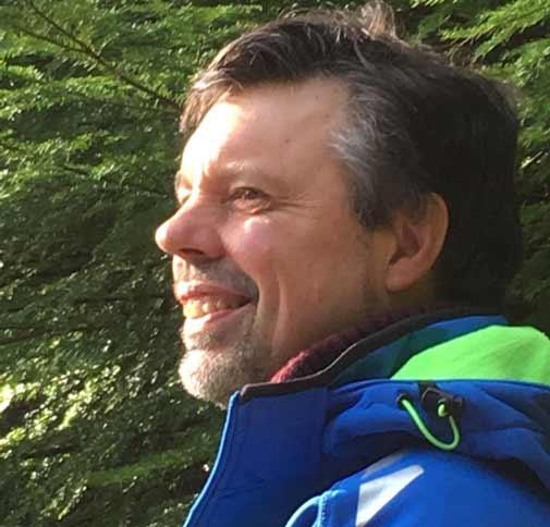Andrew Wells, Dru Yoga teacher trainer, in trees in Betwys y Coed