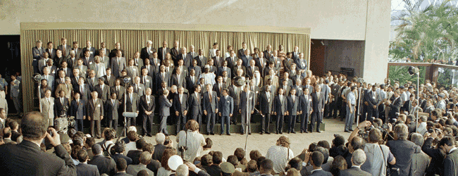 Heads of State group photo in Rio 1992, including image of Andrew Wells from Dru