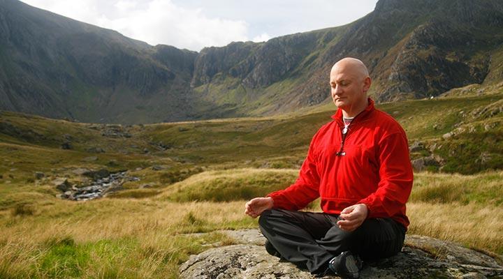 Chris Barrington meditating in nature