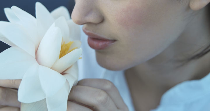 woman smelling lotus flower
