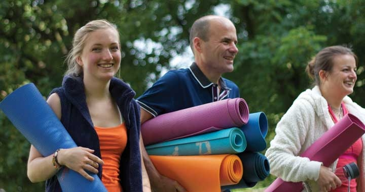Neelke, Ned and Christiane with yoga mats