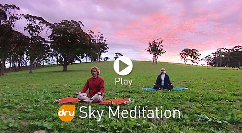 People meditating in the nature under the sky